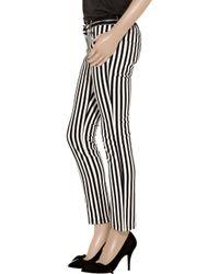 Balmain - Black Striped Low-rise Skinny Jeans - Lyst