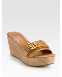 5f3a010a283f Lyst - Tory Burch Elina Pebbled Leather Logo Wedge Sandals in Brown