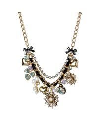 Betsey Johnson | Black Gold Tone Flower Multi Charm Frontal Necklace | Lyst
