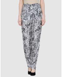 Seventh Wonderland | Black Estelle Floral-Print Silk-twill Pants | Lyst