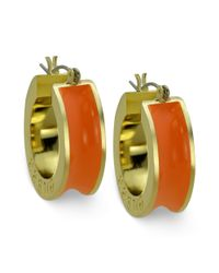 Guess - Metallic Earrings Goldtone Orange Logo Hoop Earrings - Lyst