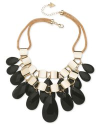 Guess - Metallic Gold-tone Two Row Jet Beaded Necklace - Lyst