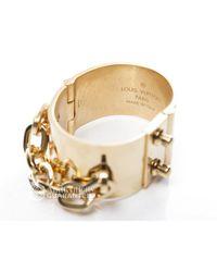 Louis Vuitton - Metallic Pre-owned Gold Lock Me Manchette Bracelet - Lyst