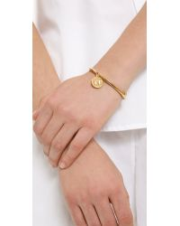 kate spade new york - Metallic Charm Letter Bangle Bracelet - Lyst