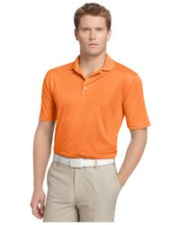 Izod | Orange Performance Solid Grid Golf Polo for Men | Lyst