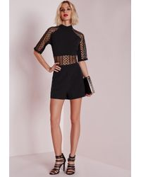 6d622b0a9f Missguided Geo Lace Insert High Neck Playsuit Black in Black - Lyst