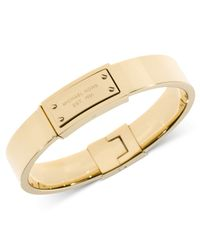 Michael Kors | Metallic Gold-Tone Logo Plaque Bangle Bracelet | Lyst