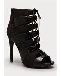 Bebe | Black Tillan Lace Up Booties | Lyst