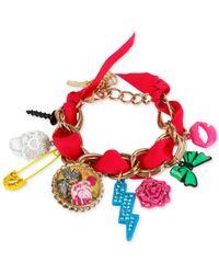 Betsey Johnson | Metallic Gold-tone Ribbon Multi-charm Flex Bracelet | Lyst