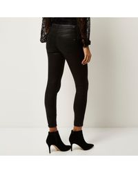 fe4d5686e40e56 River Island Black Molly Coated Lace Up Jeggings in Black - Lyst