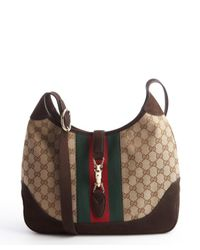 f9679b91ad0c Lyst - Gucci Beige Gg Canvas and Brown Leather Jackie Shoulder Bag ...