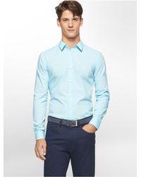 c9beeae9817 Calvin Klein. Men s Blue White Label Slim Fit Cool Tech Micro Check  Non-iron Shirt