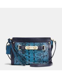 COACH | Blue Swagger Wristlet In Colorblock Exotic Embossed Leather | Lyst