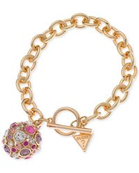 Guess - Metallic Gold-tone Fireball Pink And Lilac Crystal Charm Bracelet - Lyst