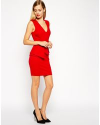 b09cc0bc66 Lyst - Asos Pencil Dress With Architectural Peplum And Plunge Neck ...