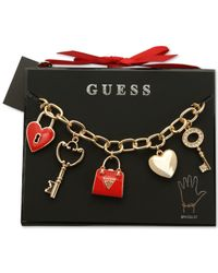 Guess - Metallic Gold-tone Crystal And Enamel Charm Gifting Bracelet - Lyst