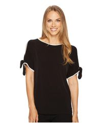 0aeeaa45cb098d Lyst - Ivanka Trump Matte Jersey Cold Shoulder Shirt in Black
