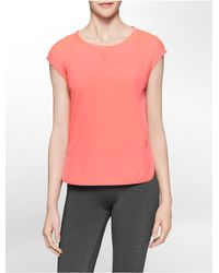 Calvin Klein | Orange White Label Performance Mesh Detail High Low Cap Sleeve Top | Lyst