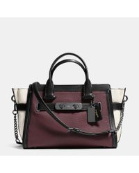 COACH - Black Swagger With Chain In Pebble Leather - Lyst