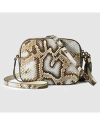 8a17bb865ddc Lyst - Gucci Soho Python Disco Bag in Natural