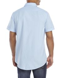 Izod - Blue Textured Woven Two-Pocket Shirt for Men - Lyst