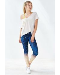 Onzie - Blue Graphic Legging - Lyst