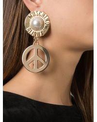 Moschino - Metallic Peace Sign Drop Earrings - Lyst