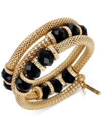 Kenneth Cole | Metallic Gold-tone Black Faceted Bead Coil Bracelet | Lyst