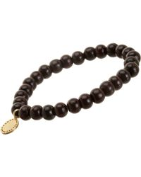 Devon Page Mccleary - Metallic Bead Bracelet With Serene Buddha Charm - Lyst