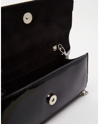 Lotus | Black Clutch Bag With Bow | Lyst