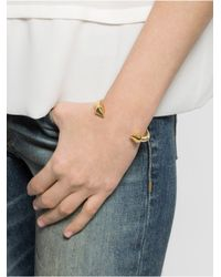 BaubleBar - Metallic Gold Cone Cuff - Lyst