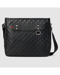 791923b7b58 Lyst - Gucci Rubber Ssima Messenger in Black for Men