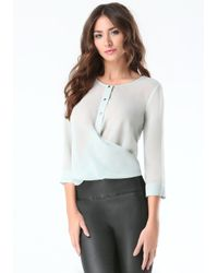 Bebe | Blue Sheer Button Up Wrap Blouse | Lyst