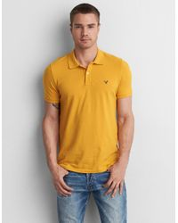 721bdc1f Lyst - American Eagle Ae Solid Pique Flex Polo in Yellow for Men