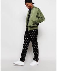 Champion - Black Joggers With All Over Print for Men - Lyst