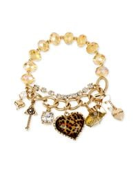 Betsey Johnson | Metallic Goldtone Leopard Multicharm And Bead Stretch Bracelet | Lyst