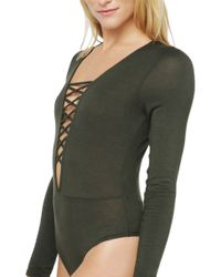AKIRA - Green Stationed Lace Front Top - Lyst