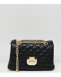 e54c9e90be8 Lyst - ALDO Menifee Black Quilted Cross Body Bag With Double Gold ...