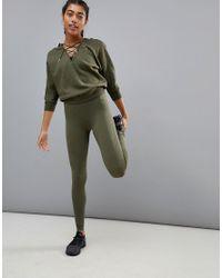 PUMA - Green Evoknit Legging - Lyst