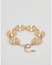 ASOS - Metallic Asos Design Curve Statement Swirl Coin Bracelet - Lyst
