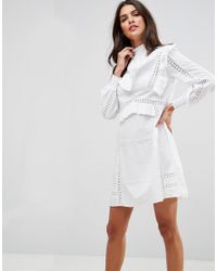 b7029e237426 Women's White Premium High Neck Cotton Swing Dress With Ruffles And Lace  Inserts