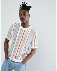 266d66f18a Men's Knitted T-shirt With Vertical Stripes In Ecru. See more ASOS Short  sleeve t-shirts.