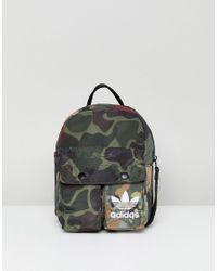 adidas Originals. Women s X Pharrell Williams Hu Camo Mini Backpack b6307acef66c0