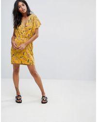 Liquorish | Yellow Wrap Front Dress In Dark Floral Print | Lyst