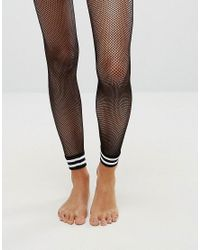 6c2163a0f42b2 Asos Stripe Cuff Footless Fishnet Tights in Black - Lyst