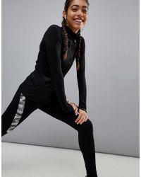 PUMA - Black Running Zip Top - Lyst