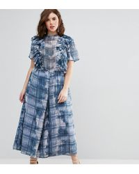 3284b575dcc Women s Blue Jumpsuit With Raw Edge Ruffle Detail In Blurred Check Print