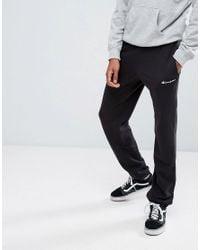 b21f877e Champion Logo Joggers in Black for Men - Lyst