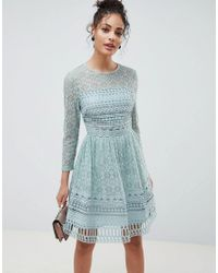 48fda5e1b85 ASOS Premium Lace Mini Skater Dress With Long Sleeves in Green - Lyst