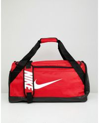 4994874821 Nike Red Swoosh Logo Duffle Bag in Red - Lyst